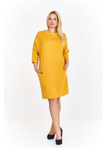 Monochromatyczna sukienka tuba