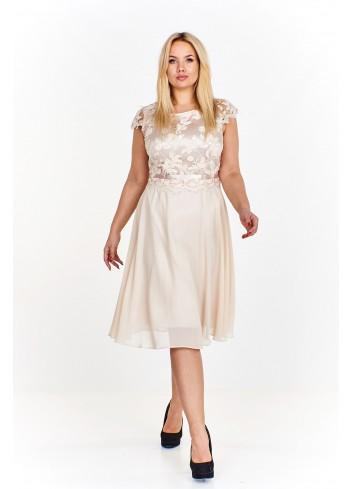 Elegancka sukienka z wyszywaną górą ozdobioną połyskującymi cekinami rozkloszowana ku dołowi