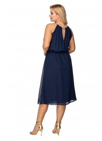tiulowa sukienka z dekoltem typu halter z odpinanym łańcuszkiem oraz wiązaniem w pasie