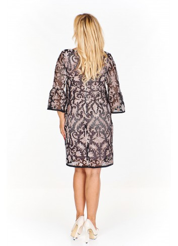 Sukienka z delikatnie prześwitującej tkaniny we wzory z fantazyjnym rękawem